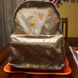 LeSportsac glimmering hearts backpack